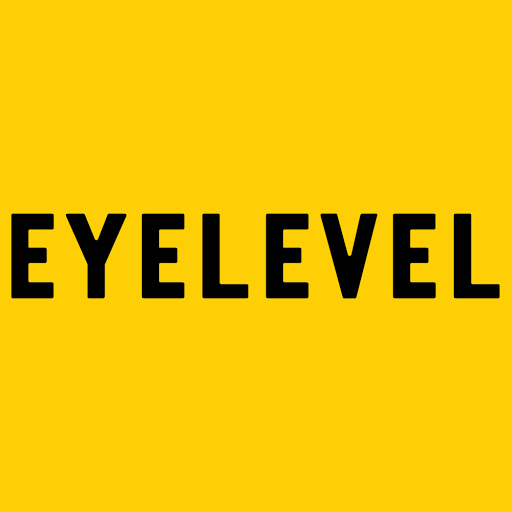 """A bight yellow background, the words """"eye level"""" are in black block lettering. Eye Level gallery"""